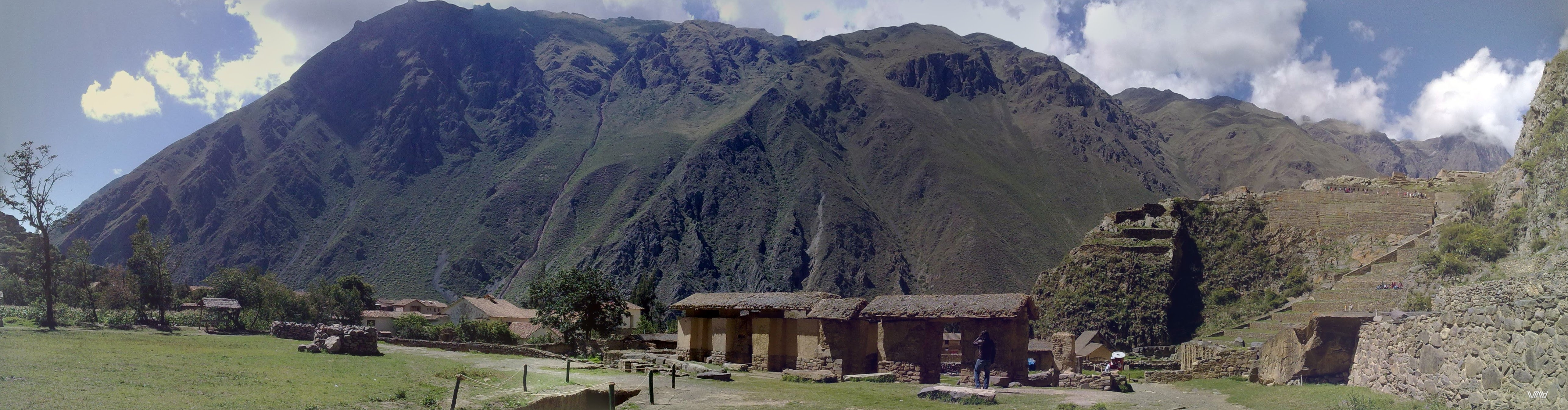 Panoramic view of the mountains and part of the construction of the ancient city of Ollantaytambo in Peru. The beauty captures the spirit.