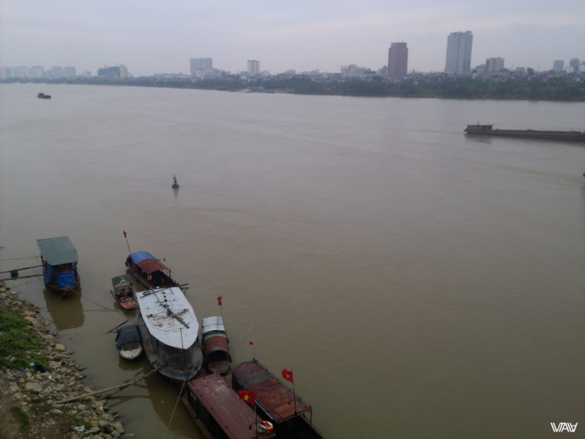 Incredibly but this river is called Red. That is a completely different color in reality. Hanoi, Vietnam